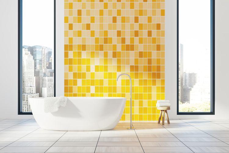 Žltý obklad v kúpeľni