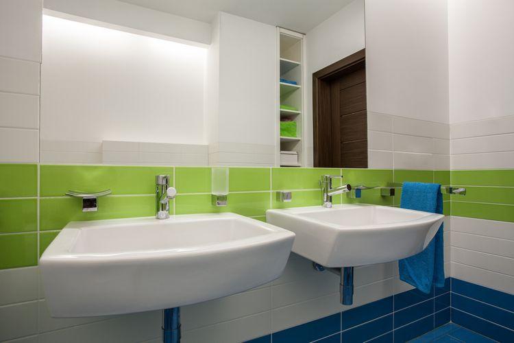 Zelené detaily v kúpeľni